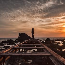 Woman on pier  by Gianluca Presto - Buildings & Architecture Bridges & Suspended Structures ( clouds, colorful, colors, sea, beach, sun, portrait, sky, girl, woman, sunset, pier, perspective, bridge, sunrise, rocks,  )