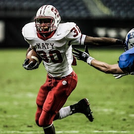 Stiff Arm by Keith Johnston - Sports & Fitness American and Canadian football ( field, defense, running back, football, ball carrier, stadium, action, runner, helmet, athletie, athletic )