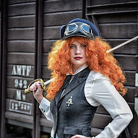 Red Haired by Marco Bertamé - People Portraits of Women ( red, goggles, lady, hait, long, young, steampunk, hat, sword )