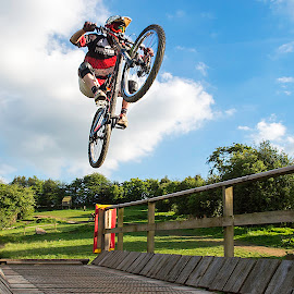 by Nick Moor - Sports & Fitness Cycling ( down hill, rider, blue sky, mountain bike, jump )