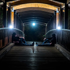 Lovers Rest by Anthony Mara - People Couples ( hats, mirror, lights, light painting, woman, shadow, couple, architecture, bridge, man,  )