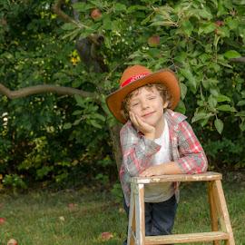 Apple Of My Eye by Chris Cavallo - Babies & Children Children Candids ( ladder, orchard, tree, hat, apples, boy,  )