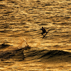 by Isaac Gershon - Sports & Fitness Surfing ( water, natural light, orange, wind, dreamy, peaceful, watersports, waterscape, kite, sea, seascape, board, sunlight, jump, epic, surfing, surfer, sailing, sunset, wave, evening )