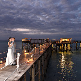 Jetty Evening Kiss by Andrew Morgan - Wedding Bride & Groom ( love, kiss, zanzibar, wedding, jetty, bride, groom )