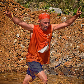 Hard But Almost Done ! by Marco Bertamé - Sports & Fitness Other Sports ( water, orange, hands up, amnéville, mud, splash, the mudday, drops, france, running, alone, man )