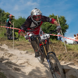 Rock Garden corner by Nick Moor - Sports & Fitness Cycling ( rock garden, down hill, blue sky, dh, mtb, racing, cornering )