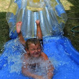 Making A Splash.... by Melanie Goins - Babies & Children Children Candids ( heat, slip'nslide, hose, water, boy, summer,  )