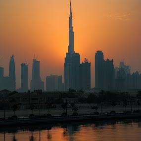 Sunrise beyond Burj Khalifa   by Salman Ahmed - City,  Street & Park  Skylines ( reflection, skyline, water canal, skyscraper, dubai, burj, sunrise, burj khalifa, morning, sun )