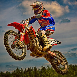 Jump'n Fly by Marco Bertamé - Sports & Fitness Motorsports ( clouds, 251, green, two hundred fifty-one, number, forest, race, jump, red, sky, motocross, fly, blue, air, alone, competition )