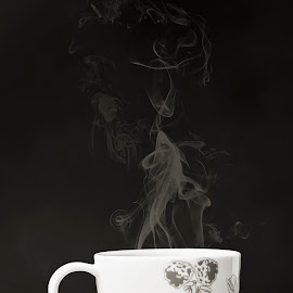 Hot cup of tea by Cynthia Linderbeck - Food & Drink Alcohol & Drinks ( tea-leaf, cup, heat - temperature, green color, herbal tea, condensation, saucer, teabag, label, leaf, tea - hot drink, objects/equipment, crockery, mug, non-alcoholic beverage, food and drink, concepts and ideas, porcelain, no people, string, drink, tea cup, steam )