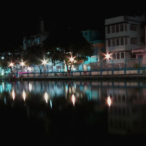 one calm city evening by Jayanti Chowdhury - Landscapes Starscapes ( star bursts, lighting, waterscape, landscape, nightscape )