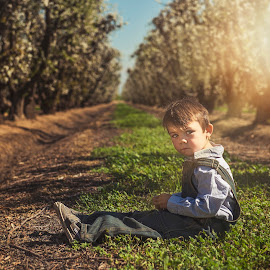 Relaxing in the Orchard  by Chrystee G - Babies & Children Children Candids ( nikonshooter, california, orchard, farmland, central california, sunlight, toddlers, spring, overalls, sunny, little boy, d800, trees, toddler, nikon )