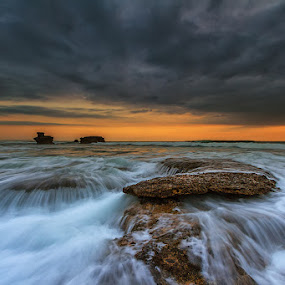 Cloudy Sunset by Satrya Prabawa - Landscapes Waterscapes ( canon, water, bali, kintamani, 7d, waves, long exposure, beach, rocks, sun )