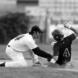 Sliding into second base by Keith Johnston - Black & White Sports ( infield, second base, sliding, baseball, tag, dust, infielder, game, runner, competition )