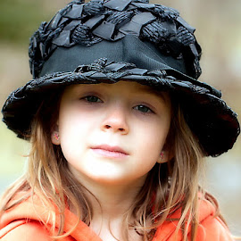 Black Hat by Sandy Considine - Babies & Children Child Portraits ( orange sweatshirt, black hat, young girl )