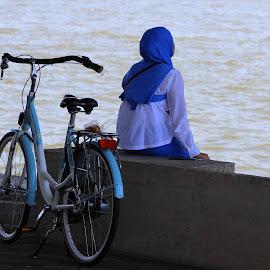 Blue by Hilda van der Lee - People Street & Candids ( bike, blue, lady, at the waterfront, city )