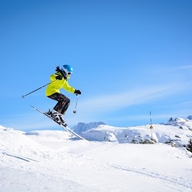 Catching some air by Amy Matthes Okasinski - Sports & Fitness Snow Sports ( skiing, jumping, snow, alpe d'huez, france )