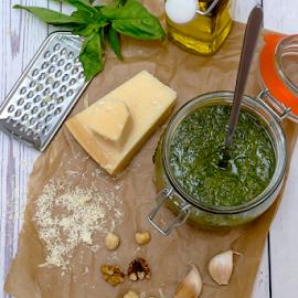 Homemade Pesto by Yancho Zapryanov - Food & Drink Ingredients ( pesto, gourmet, recipe, sauce, freshness, vegetable, cheese, parsley, oil, top, vegetarian, olive oil, walnuts, wood, cooking, diet, nobody, herb, organic, table, garlic, green, ingredient, homemade, basil, copyspace, cuisine, italian, vegan, aromatic, menu, food, flavor, traditional, closeup, nuts, healthy, fresh, spices )