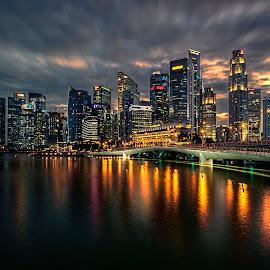 by Gordon Koh - City,  Street & Park  Skylines ( shenton way, clouds, skyline, reflection, riverfront, cityscape, singapore, lights, urban, fiery, cbd, skyscraper, sunset, asia, dramatic, night, waterfront, jubilee bridge )