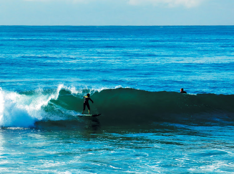 Surfers enjoy the famed Durban waves
