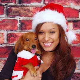 Roma and Domino by Sean Williams - People Family ( studio, snuggle, female, woman, christmas, contest, christmas card, smile, dog, eyes, hat )