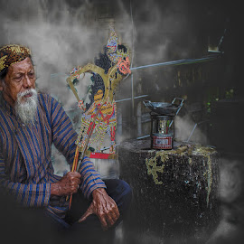 Javanesse Puppeteers by Indrawan Ekomurtomo - People Portraits of Men