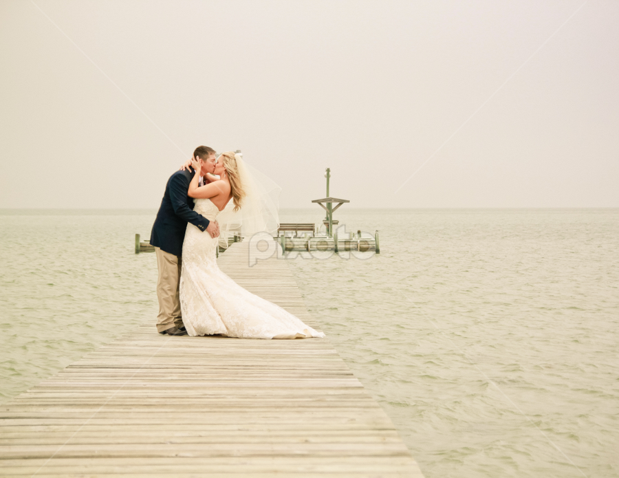The Sea of Love by Robin Haws - Wedding Bride & Groom ( honeymoon, wedding, pier, ocean, bride and groom )