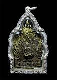 เหรียญหล่อโบราณพุทธรูปพุทธบาทระฆัง ปี2485 พระครูสถิตธรรมสร(เอม) วัดคลองโปร่ง จ.สุโขทัย เลี่ยมเงิน