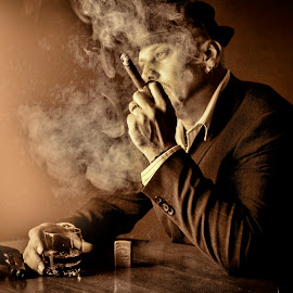 waiting by Nick-Nikola Mraovic - People Portraits of Men ( cigar, whiskey, drink, dark, gun, smoke )