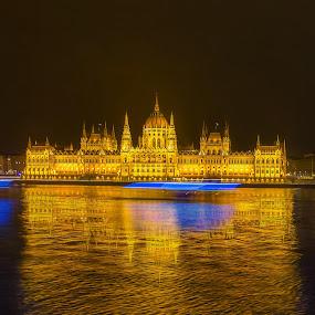 Budapest Parliament by Srdjan Vujmilovic - Buildings & Architecture Public & Historical ( water, hungary, parliament, budapest, blue, ship, trail, land, long exposure, architecture, landscape, danube, river,  )