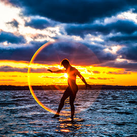 A Flare for Balance by Kyle Re - People Portraits of Men ( waves, outdoor, color, balance, sunset, contrast, silhouette, kylerecreative, clouds, portrait, people, water,  )