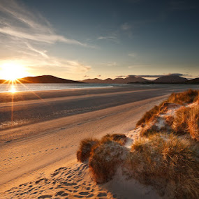 Beach on the Isle of Harris in Scotland by Pete Barnes - Landscapes Beaches ( sand, scotland, selibost, warm, isle of harris, dune, harris, beach photography, travel, beach, holiday, sunburst, mountains, sky, sunset, taransay )