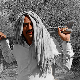 The wood chopper by Fawad Hashmi - People Professional People (  )