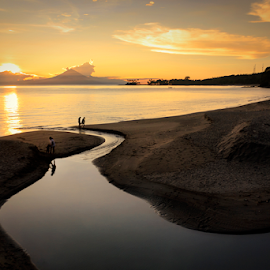 The Sunset And Human Activity  by Fahmy Dwiputra - Landscapes Beaches