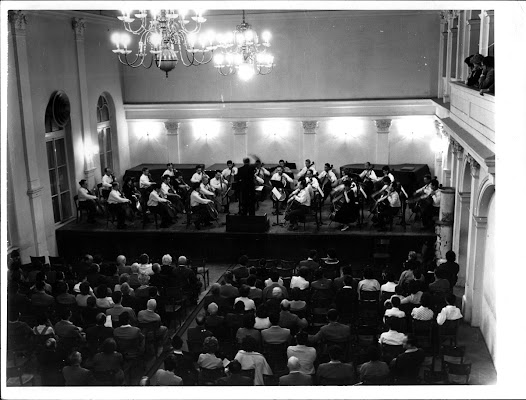 Another photograph shows Matz conducting a cello orchestra that is performing in 1960.
