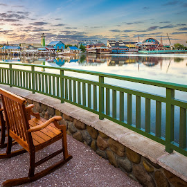 Sunrise over Disney Springs by Sarah Noonan - City,  Street & Park  Markets & Shops ( skyline, disney world, rocking chairs, downtown dsney, disney, disney springs )