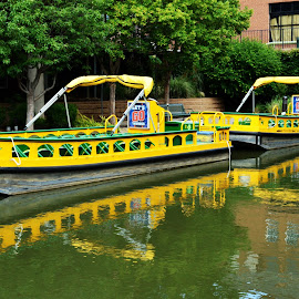 Water Taxis by Clarence Hagler - City,  Street & Park  Street Scenes ( yellow boat, oklahoma city, bricktown, water taxi, canal,  )