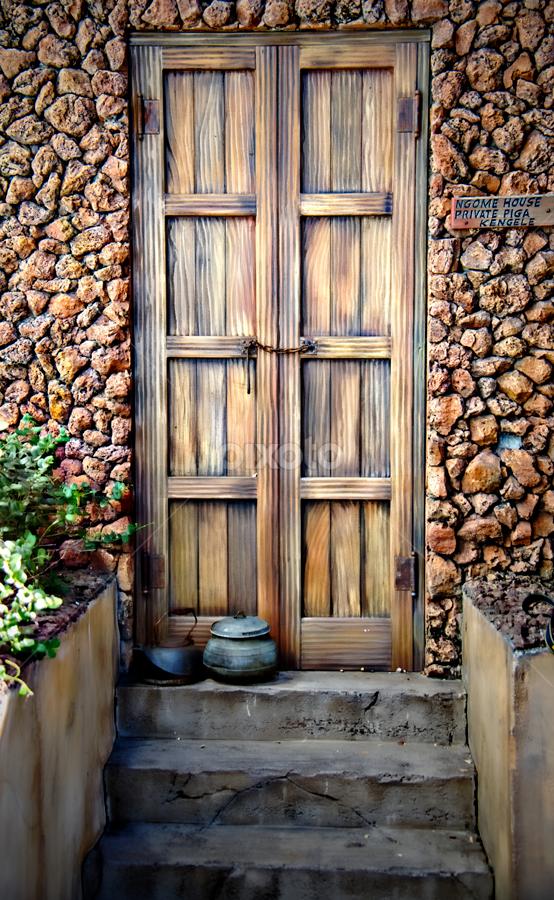 Entrance by Michelle Edwards - Buildings & Architecture Other Exteriors ( kettle, exterior, door, rock, front, steps, pot, entrance )