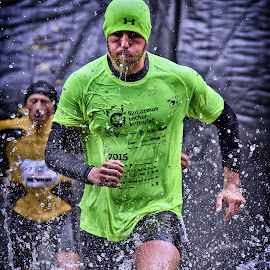 Through Thickly And Thinly The Target To Achieve by Marco Bertamé - Sports & Fitness Other Sports ( water, differdange, splash, splatter, green, 2015, concentrated, yellow, waterdrops, running, luxembourg, strong, determined, drops, strongmanrun, man )