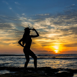 Yippie Ki Yay by Kenneth Everett - Landscapes Sunsets & Sunrises ( dawn, woman, silhouette, cowgirl, ocean, beach, sunrise, daybreak, morning, atlantic )