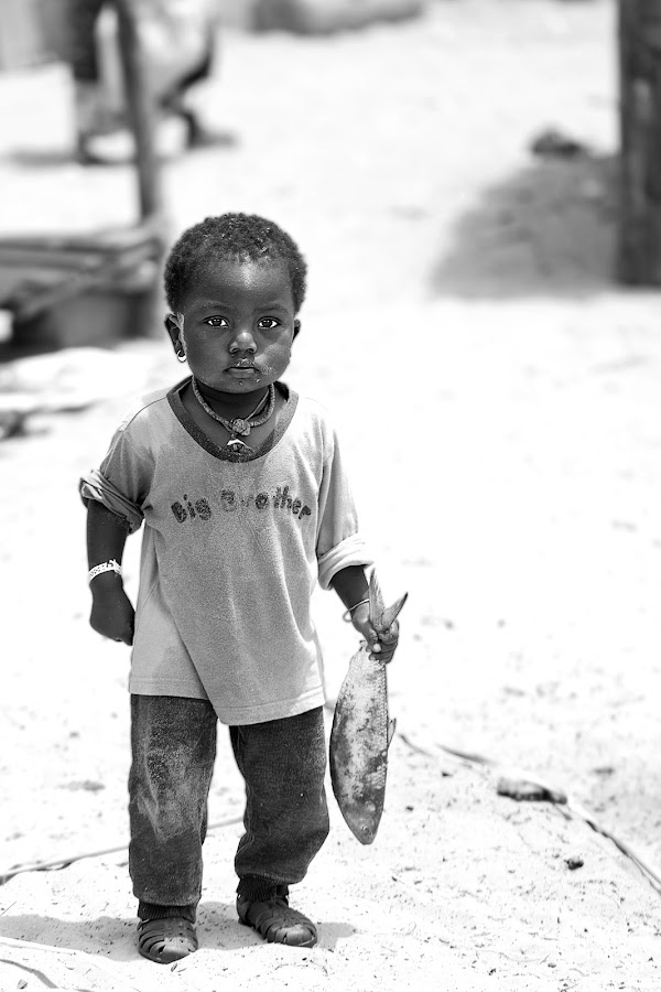 that's mine by Sabina Lombardo-Salmina - Black & White Portraits & People ( young boy, black and white, fish, proud, senegal )