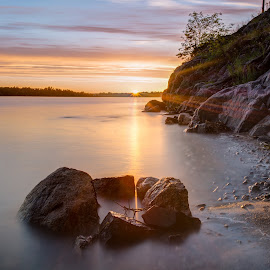 Last ray's by Juho Mäkinen - Landscapes Beaches ( water, ocan, cliffs, hdr, summer, sea, finland, long exposure, beach )