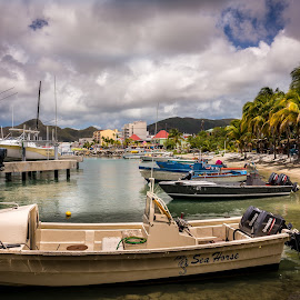 Marina and beach by Lloyd Lande - Landscapes Travel ( saint maarten, boats, marina, beach, docks )