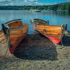 Boats by Darrell Evans - Transportation Boats ( water, shore, rowing boat, boats, pebbles, lake, row, lake district, ambleside, red, rope, blue, transport, windermere, outdoor, bow )