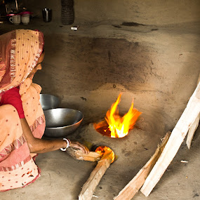 An Indian Housewife and her oven  by Snehasis Daschakraborty - People Street & Candids