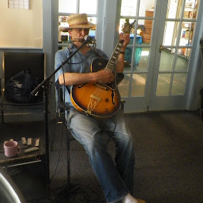 Man with harmonica and guitar by Stephen Deckk - People Musicians & Entertainers
