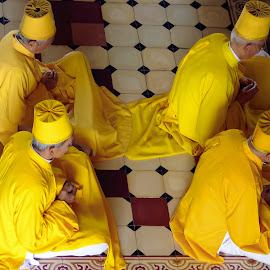 Mediation by Kathryn Potempski - People Street & Candids ( holiday, candid, meditation, vietnam, men, yellow, travel, photography )