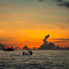 Fishing at sunset by Natalia Dobrescu - Landscapes Waterscapes ( canon, explore, scape, waterscape, canon70d, vietnamese, ocean, beauty, travel, seaside, people, photography, sun, adventure, asia, halong bay, golden hour, beautiful, discover, vietnam, seascape, boat, fishermen, sun ray, sunset, night, fishing )