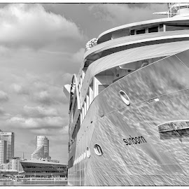 Yacht in the Dock by Heather Ryder - Buildings & Architecture Office Buildings & Hotels ( water, tower blocks, london, buildings, yacht, dockland, river )