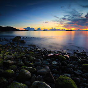 Pulau Tiga by Rudy Harianto - Landscapes Sunsets & Sunrises ( blue, sunset, cloudy, beach, stones )